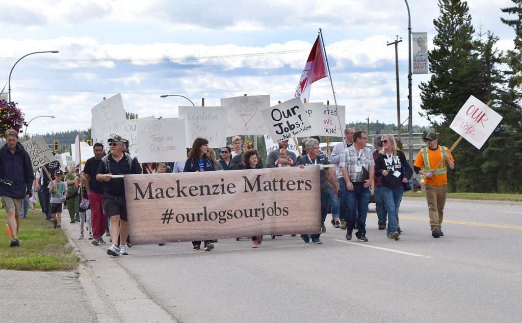 "Close to 1,000 people marched through the streets of Mackenzie and then attended a two-hour rally in support of the forest industry in the region. Organized my #MackenzieMatters the slogan of the day was ""Our logs, Our jobs,"" which is a call for timber harvested in the region to be processes in the region. Bill Phillips photo"