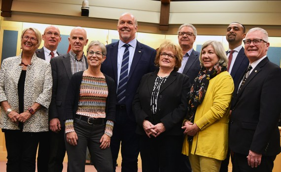 Mental Health and Addictions Minister Judy D'Arcy (left), Vanderhoof Mayor Gerry Thiessen, Quesnel Mayor Bob Simpson, Municipal Affairs Minister Selina Robinson, Premier John Horgan, Mackenzie Mayor Joan Atkinson, Prince George Mayor Lyn Hall, Fort St. James Mayor Bev Playfair, Parliamentary Secretary Ravi Kahlon, and Forests Minister Doug Donaldson at the Northern Mayor's Roundtable in Prince George. Bill Phillips photo