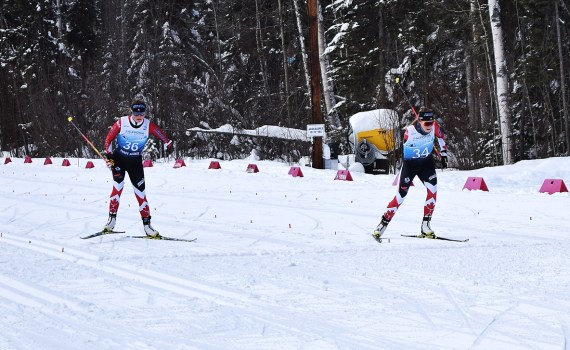 Canadians Brittany Hudak (left) and Emily Young cross the finish line of the Women's Sprint Standing competition virtually in a dead heat. Bill Phillips photo