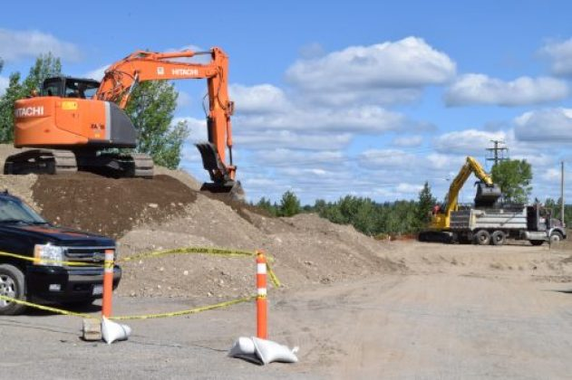Crews work on extending Recplace Drive through to Pine Centre Mall. Bill Phillips photo