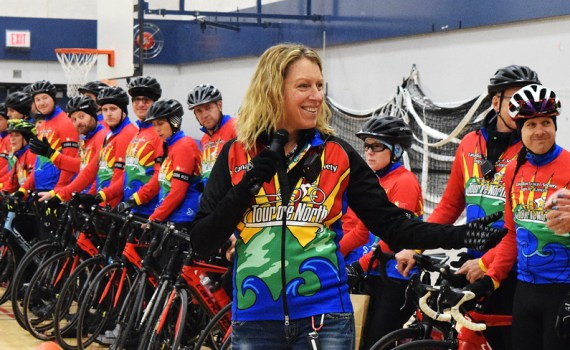 Cops for Cancer Tour de North organizer Erin Reynolds of the Canadian Cancer Society greets riders and support staff. Bill Phillips photo