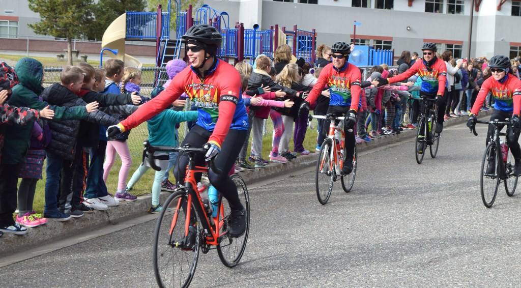 Heather Park Elementary School students cheer Cops for Cancer Tour de North riders as they start their bike journey to Prince Rupert. Bill Phillips photo