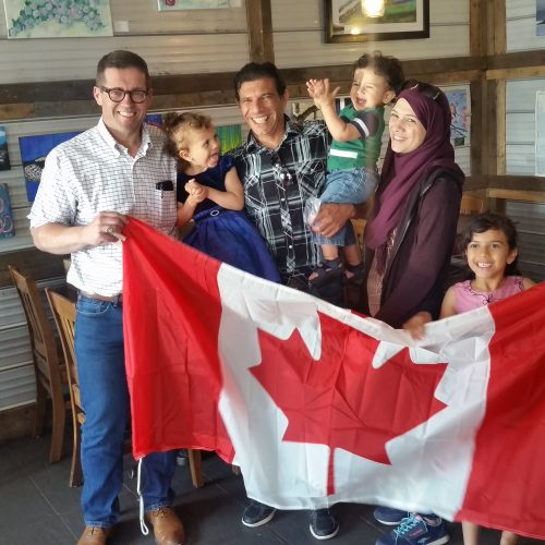 MP Bob Zimmer with Isam Sharkiye, his wife Marwa and their three kids at the Meet Your MP For Coffee event in Fort Nelson.