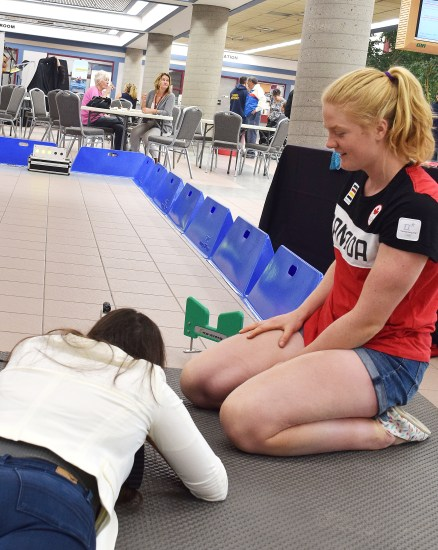 Olympic biathlete Sarah Beaudry gives some pointers during a demonstration of what it's like to shoot a biathlon rifle. Bill Phillips photo