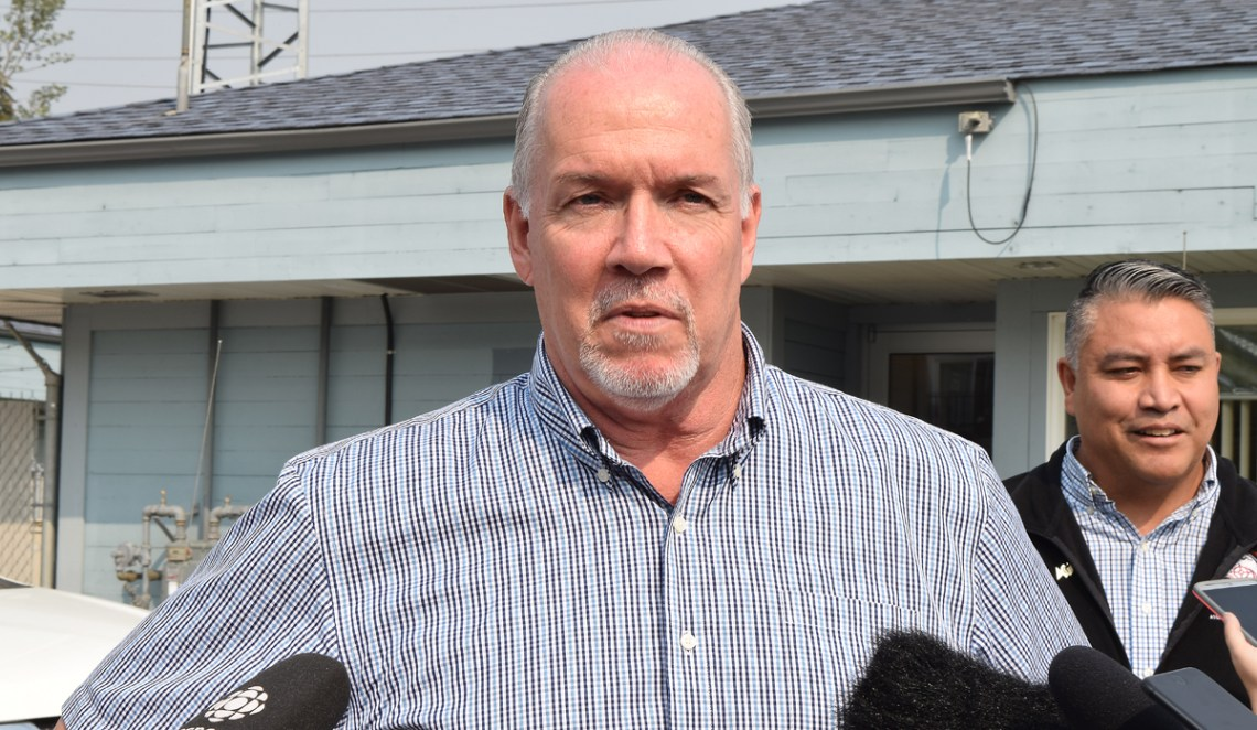 Premier John Horgan talks with media in Prince George Tuesday morning. Bill Phillips photo