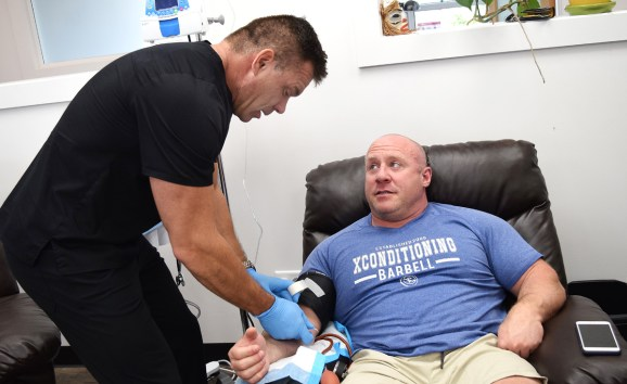 Competitive powerlifter and XConditioning owner Mike Webber gets an intravenous treatment of vitamins and minerals from Dr. Jason Boxtart Northern Centre for Integrative Medicine. Bill Phillips photo