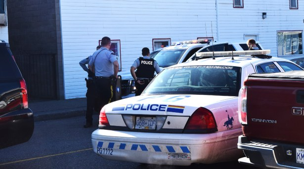 RCMP officers respond to a call for immediate assistance from a fellow officer at an apartment building on Quebec Street Thursday morning. Bill Phillips photo