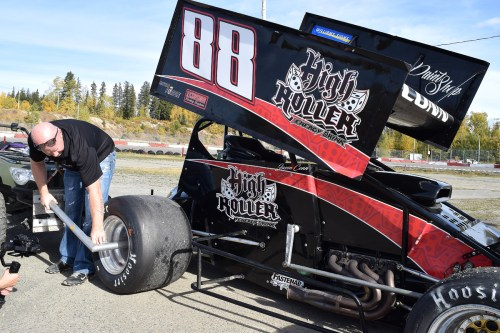 Jason Conn tightens the wheels of his sprint car prior to taking it for a run at PGARA. Bill Phillips photo