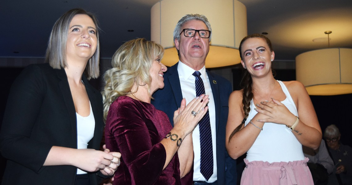 Lyn Hall, with his wife Lorelle, and daughters Syndney and Jordan at his side, watch election results come in as Hall was elected to a second term as mayor of Prince George. Bill Phillips photo