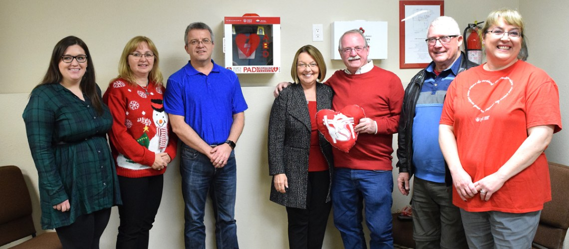The Team Bond Big Bike Ride team with the automated external defibrillator they have given to the North Central Seniors Association on behalf of the B.C. Heart and Stroke Foundation. Bill Phillips photo
