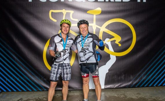 Scott and David McWalter at the end of the 2018 Ride to Conquer Cancer.