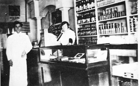 """Mr. and Mrs. Teddy Pappas in their store on George Street, 1918."" Copyright The Exploration Place."