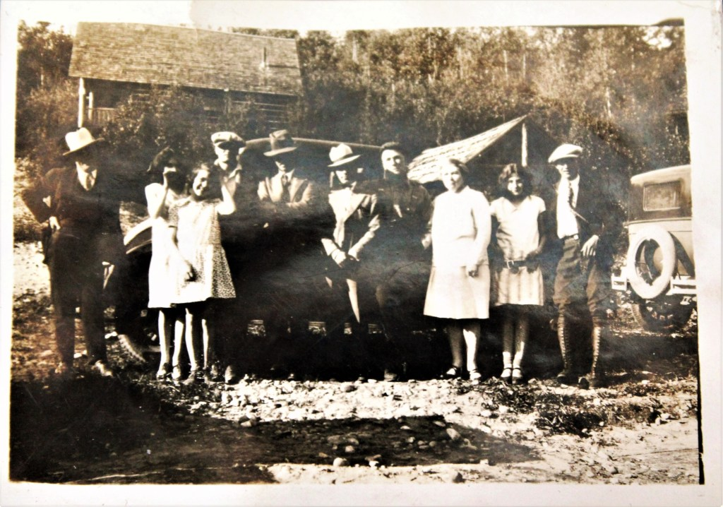 L-R: Unknown, unknown, May Huble, unknown, Ivan Wyant, Ted Pappas, Albert Huble, Annie Huble, Pat Huble, Dick Dully at Summit Lake, circa 1928. Copyright Huble Homestead/Giscome Portage Heritage Society.