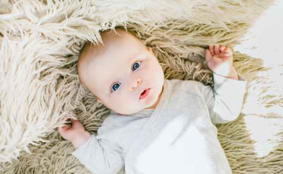 baby in white onesie