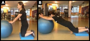 Woman working out abs with ball.