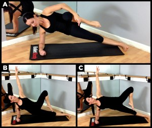 Woman working out with side plank.