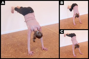 Woman exercising on the wall.