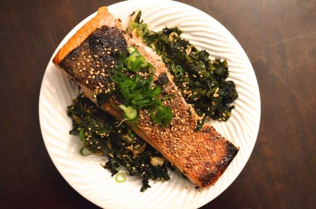 crisp salmon on sesame spinach