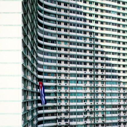 A huge block of flats sporting a Cuban flag