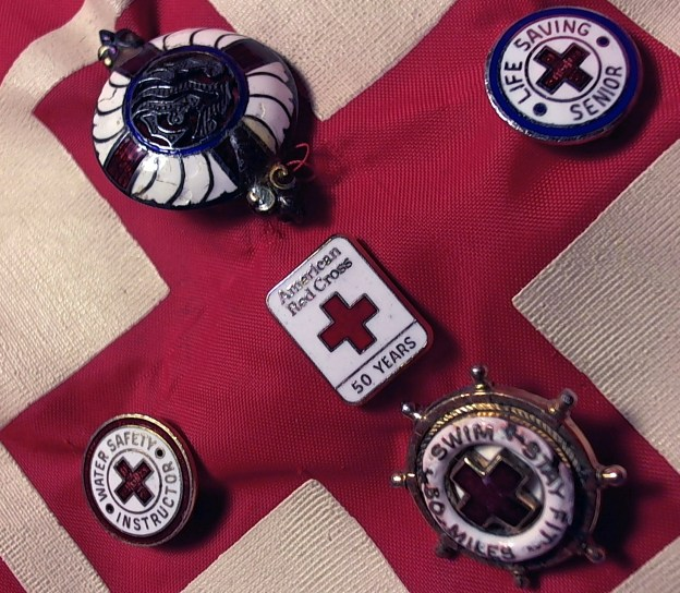 red cross with pins