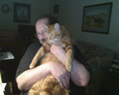 Louie was a big cat. Sometimes he'd jump up on your lap without warning.