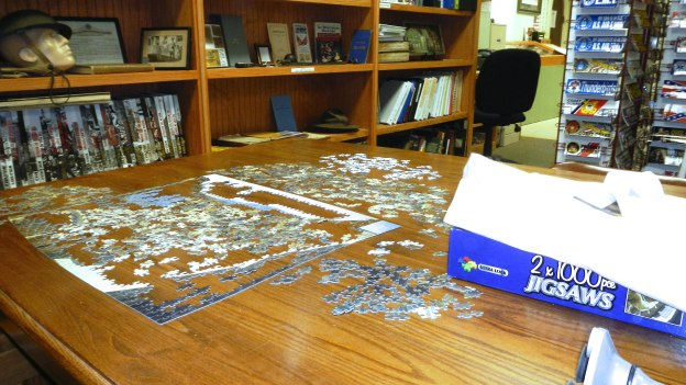 1000-piece puzzles often help pass the three hours. Some days, no visitors come in. Other days, whole groups do.
