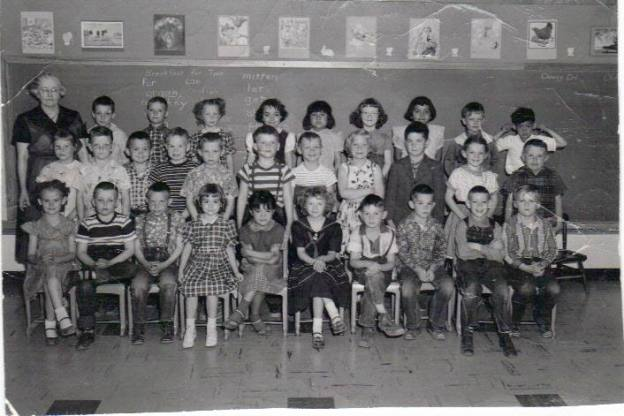 I'm the cute little rascal in the second row, three in from the right. Curiously enough, I was wearing a jacket at an inappropriate time, something I am likely to do these days. It's a matter of having enough pockets, or so I'll tell you!