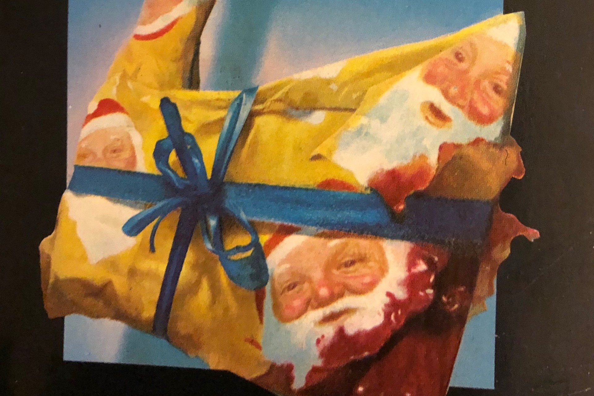 Close up shot of an illustrated bloody ax covered in wrapping paper.