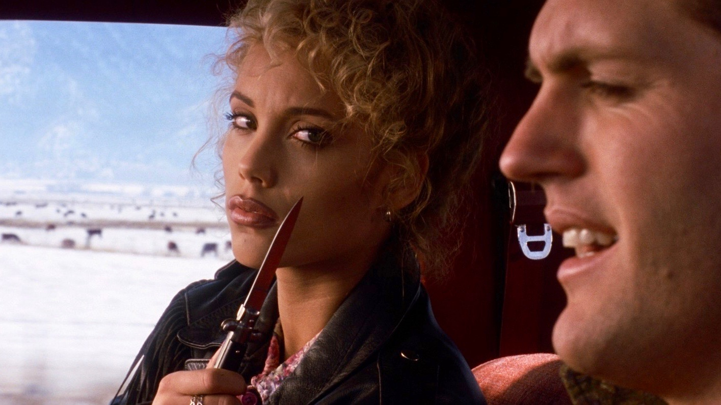 """Nomi Malone shows off her switchblade in the opening scene of """"Showgirls"""""""