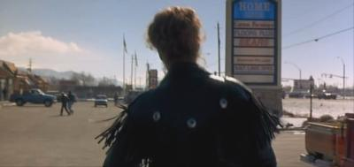 Nomi in her leather jacket headed to hitchhike to Las Vegas.