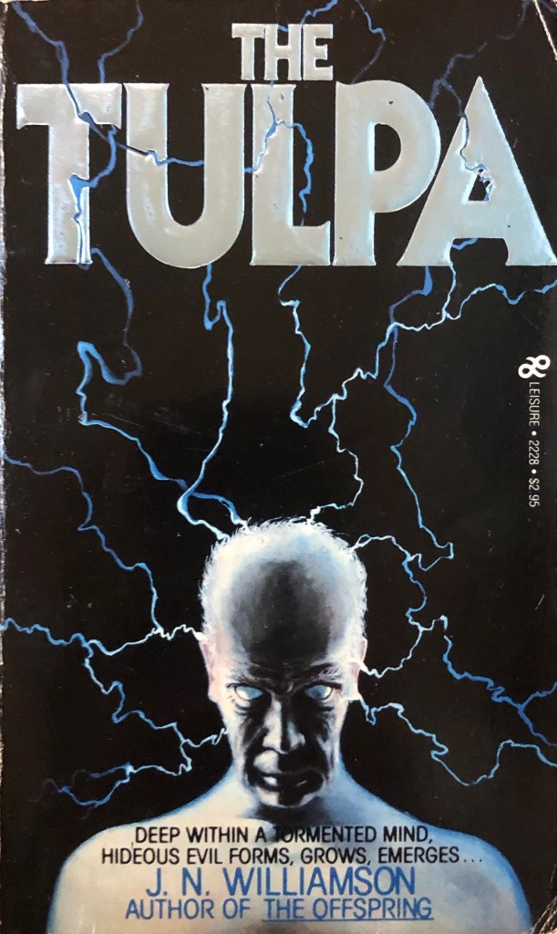 "On the original cover of J. N. Williamson's ""The Tulpa,"" an older, balding man stares, his eyes white, while lightning flashes."