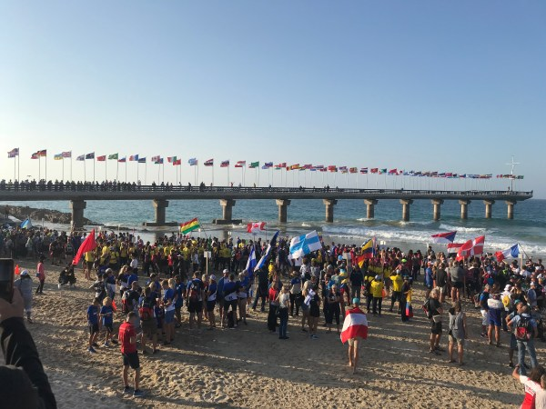 A collection of athletes with national flags on Port Elizabeth Beach