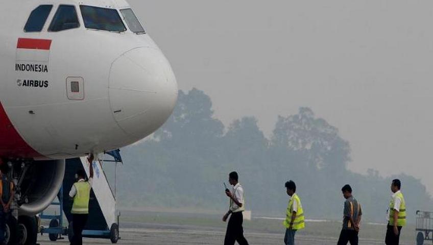 kabut-asap-di-bandara-sultan-syarif-kasim