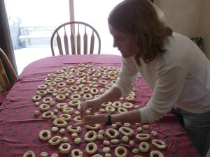 Laying doughnuts on table