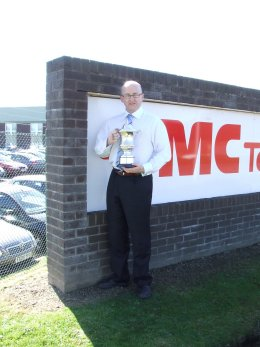 John Johnston holding the Lord Cullen Trophy