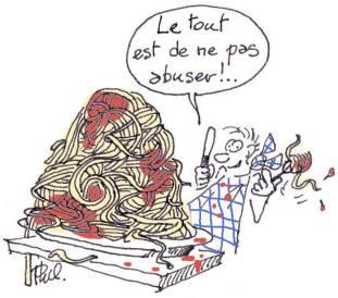 Homme attabé devant une immense assiette de spaghettis.