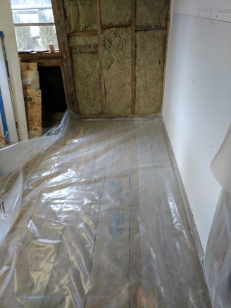 After insulating, I put down a vapour barrier. I did this on the floor as well as it is open air and high moisture under the shop.