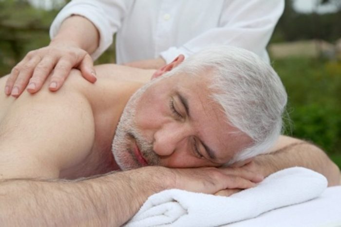 Elderly man gets a gentle yet effective massage