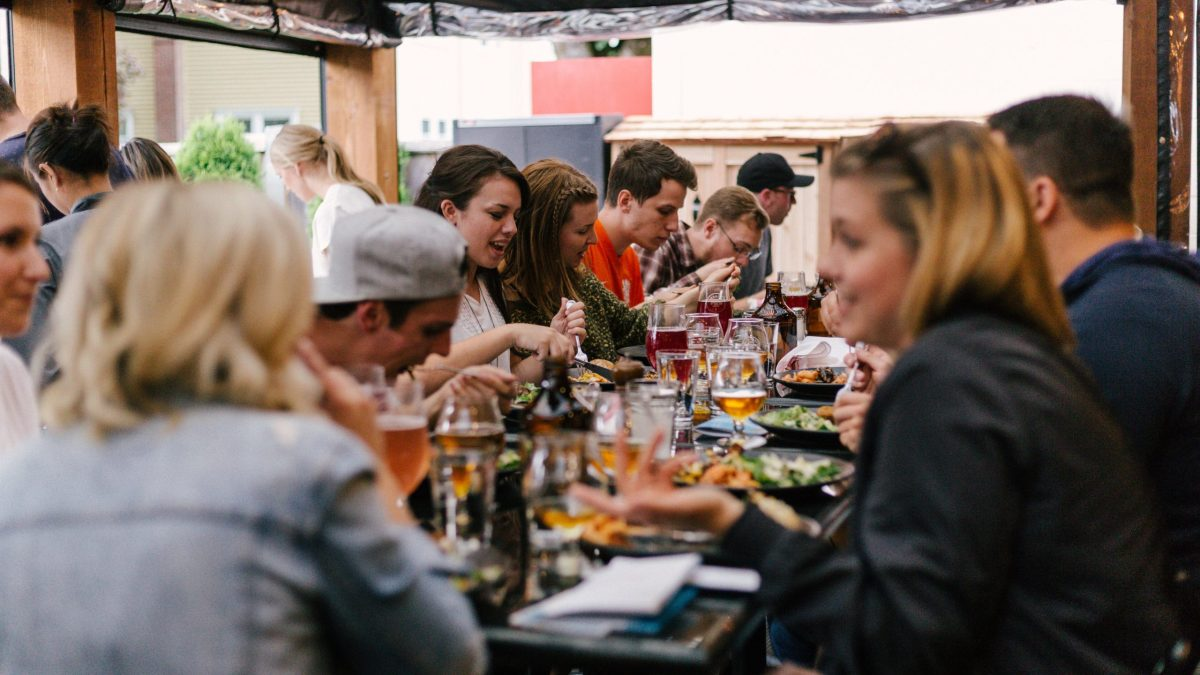 People eating at a table together