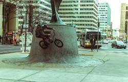 Scaling city monuments via bike outside City Hall