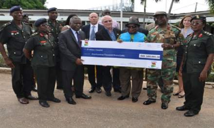 Jubilee Partners support diaster victims with a cheque donation to 37 Military Hospital