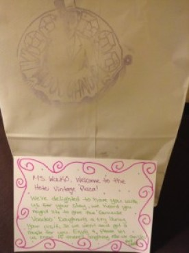 Personalized welcome note and Voodoo doughnuts