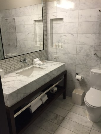 Deluxe King Bathroom at Eventi Hotel Kimpton NYC