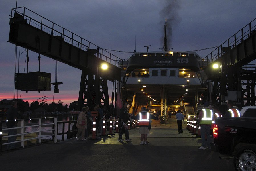 Offloading vehicles in Ludington at dusk