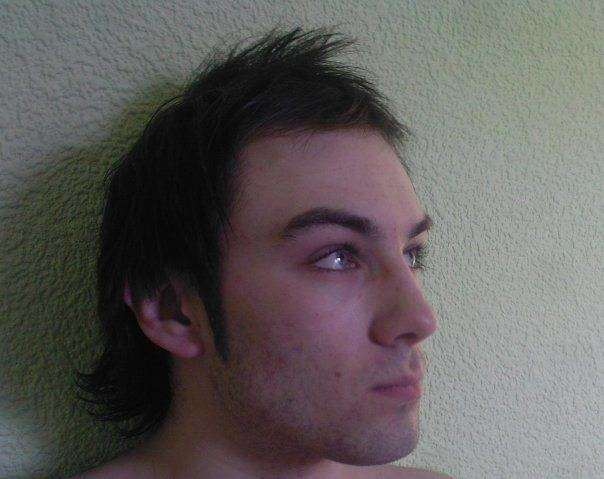 My somewhat less moody, equally bad-haired, 18 year old self...unfortunately I pre-date Facebook and thus don't have any older picture!