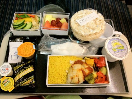 Saffron Rice, Grilled Fish, Grilled Vegetables, Rice Cakes, and Fruits