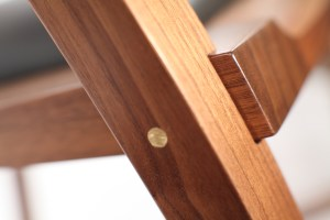 Closeup of The Brass Pin in the Walnut Morley Rocker blurred backgroun