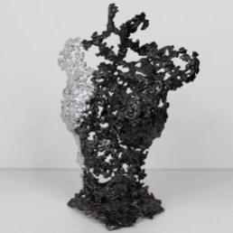 Sculpture représentant un buste de femme en métal : dentelle d'acier et Chrome Pavarti Soleil levant Pièce unique