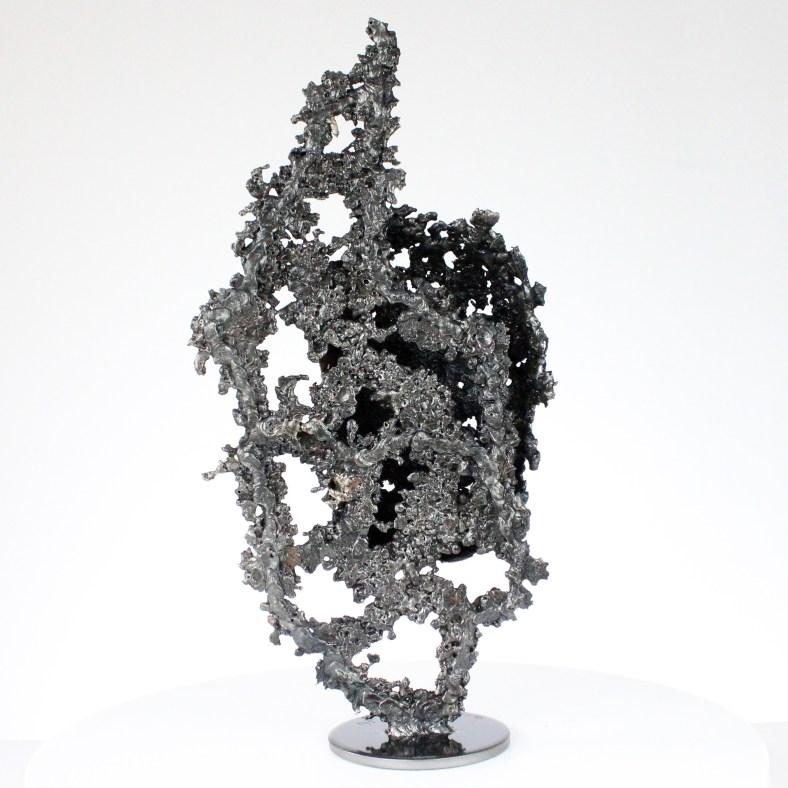 une larme VI sculpture visage metal acier bronze a tear III face sculpture metal steel bronze philippe BUIL