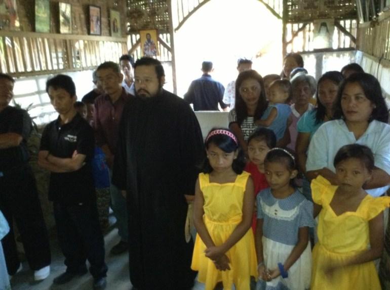 Father Philip with parishioners